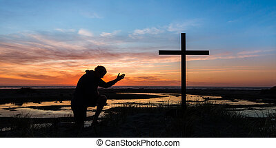 Hand of Prayer Sunset - an with the sunset behind him...