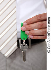 hand of realtor holding key