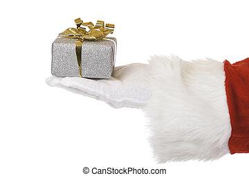 Hand of Santa Claus holding Christmas present
