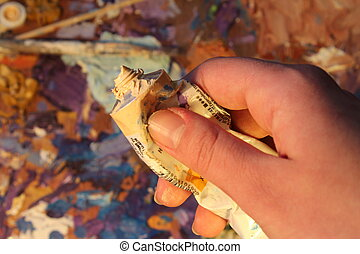 hand of the artist, a tube of paint