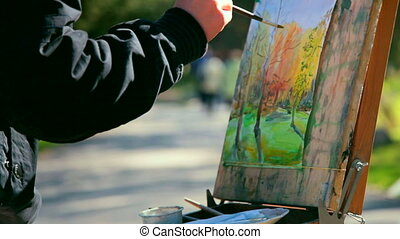 hand of the artist with paintbrush