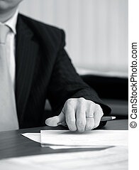 Hand of the businessman with pen