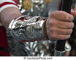 Hand of the Empire - Roman centurion\'s arm dressed in...