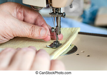 hand of the old woman put to thread a needle sewing machine