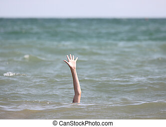person during the drowning in the sea asking for help