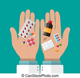 Hand of the pharmacist with pills and drugs
