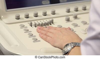 Hand of woman and ultrasound examination medical equipment....