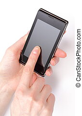 Hand of woman holding mobile phone and touching blank screen