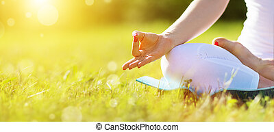 hand of woman meditating in lotus position practicing yoga
