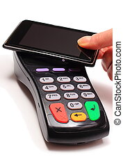 Hand of woman paying with NFC technology on mobile phone