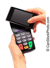 Hand of woman paying with NFC technology on mobile phone,...