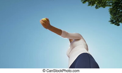 Hand of woman tennis player throwing and catching a ball