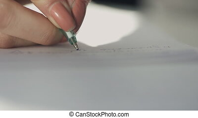 Hand of woman writing with pen on paper in premise.