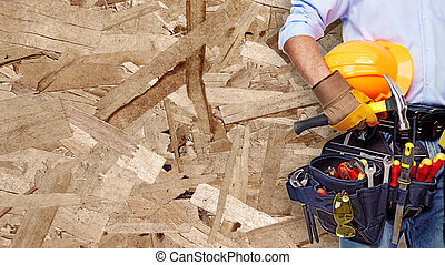 Hand of Worker with construction tools.