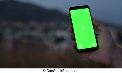 Hand Of Young Man Using Phone At Night