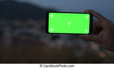Hand Of Young Man Using Phone In Nature At Night