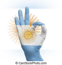 hand OK sign with Argentinian flag