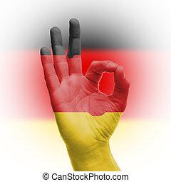 hand OK sign with German flag