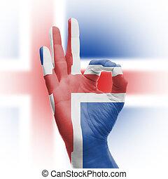 hand OK sign with Icelanic flag