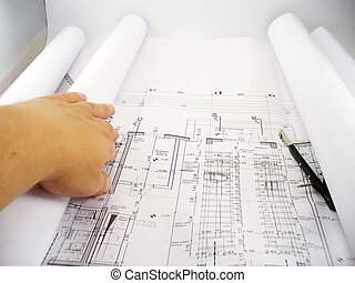 Hand on blueprints