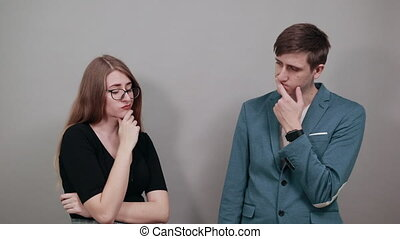 Hand on chin thinking about question, pensive expression. Doubt. Thoughtful face. Using that incredibly sharp business mind. Attractive couple boyfriend girlfriend two people, dressed black t-shirt