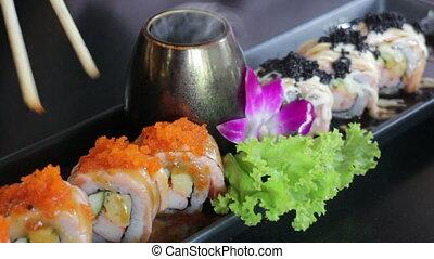 Hand On Chopsticks Enjoy Salmon Sushi With Orange Ebiko