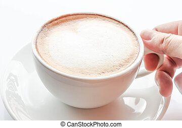 Hand on cup of hot coffee latte