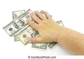 Hand on dollars
