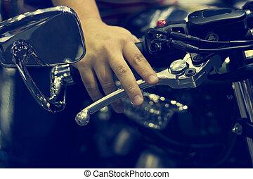 Hand on handlebars motorcycle