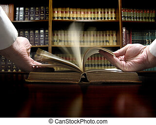 Hand on Law Book - Hands turning pages in old law book with...