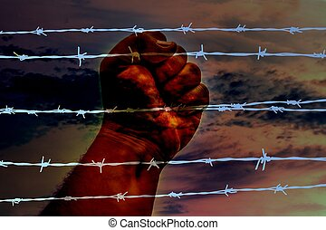 Hand on rusty barbwire