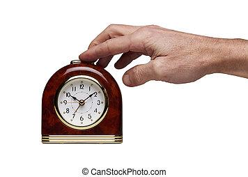 Hand on Special Juke-box Alarm clock isolated
