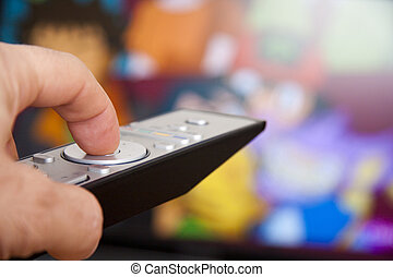 hand on the tv remote channel changing