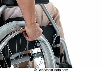 hand on wheelchair - hand of senior woman on wheelchair