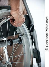 hand on wheelchair - hand of senior woman on wheelchair