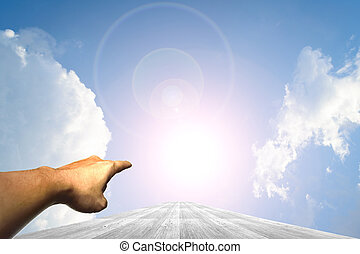 Hand on Wood way and Blue sky background