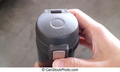 Hand opened eco-friendly reusable thermo bottle, stock footage