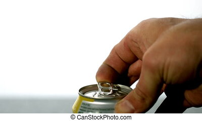 Hand opening a soda can in slow motion