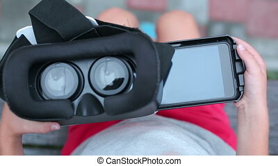 Hand opening and closing cover of virtual reality glasses. Affordable VR goggles for mobile phone