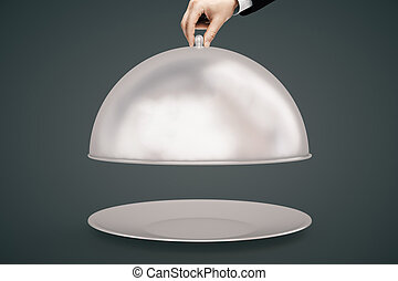 Hand opening cloche dark background - Man's hand opening...