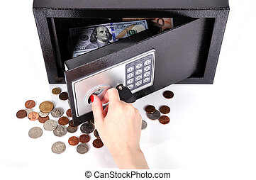 hand opening safe with dollars and cent