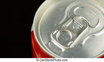 Hand opens a can of soda, top view