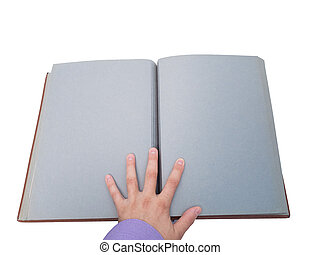 hand opens an old book.