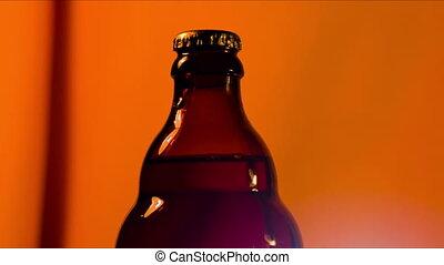 Hand opens bottle
