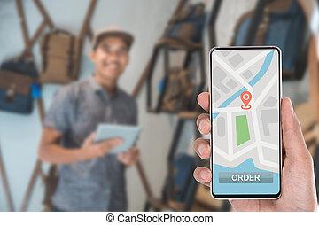 hand ordering stuff via mobile phone