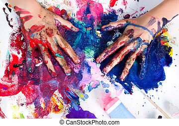 Hand painting art - Painted hands smudging colors on messy...