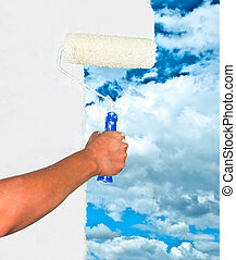 Hand painting sky on white wall