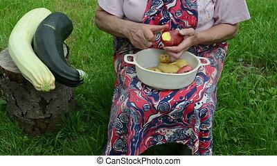 hand peel potato zucchini - fast speed up scene view senior...
