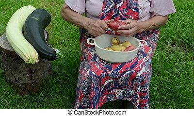 hand peel potato zucchini - old senior woman hands peel...