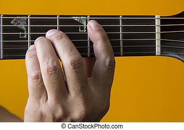 B chord on guitar - Hand performing B chord on guitar